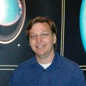 माईक ब्राउन जिन्हे प्लूटो की ग्रह से वामन ग्रह की अवनति के लिये जाना जाता है।